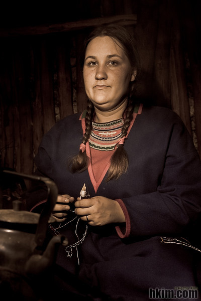 Northerner<br /> Sami girl knitting in her hut<br /> Sweden