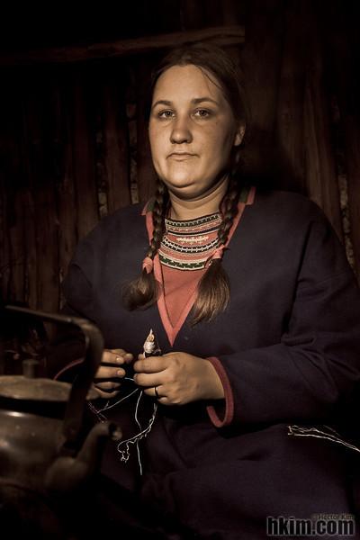 Northerner<br /> Sami girl knitting in her hut<br /> Sweden