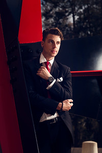 Fashion model in a suit and red tie