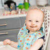 Baby Boy with Food on his Face in a Highchair