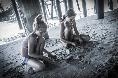 Playing under the pier.