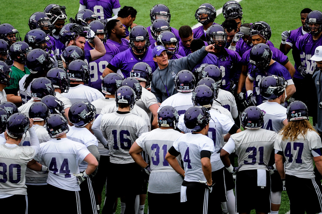 Weber State Football Head Coach Jay Hill (center) talks with this team during the first practice of the season at Stewart Stadium in Ogden on March 24, 2015.