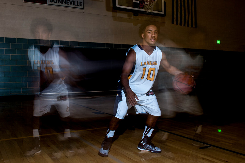 "A long exposure portrait of Bonneville High Laker Kobe Beatty shows his movements during a 2.5 second period in the gym of Bonneville High School on February 7, 2015. The junior from South Ogden was put on the starting line up this season and says the most important thing to him is to ""play with heart."""