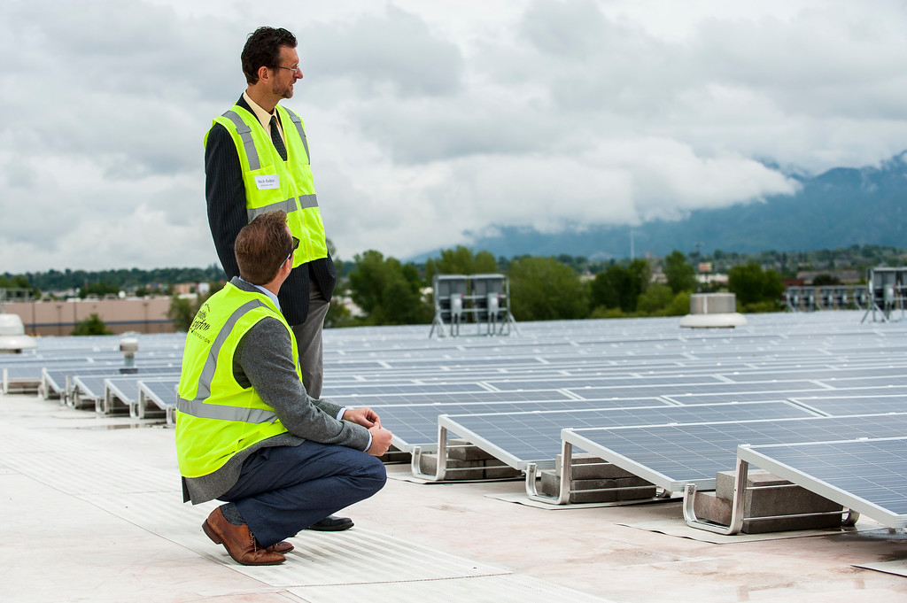 Nick Babic and Kevin Bassalleck of Affordable Solar look over the 4,066 solar panels that their company was responsible for installing on the rooftop of Smith's Food and Drug Distribution Center in Layton on May 19, 2015. The project is the second largest in the state of Utah and the panels will cut the center's energy consumption by 20%.