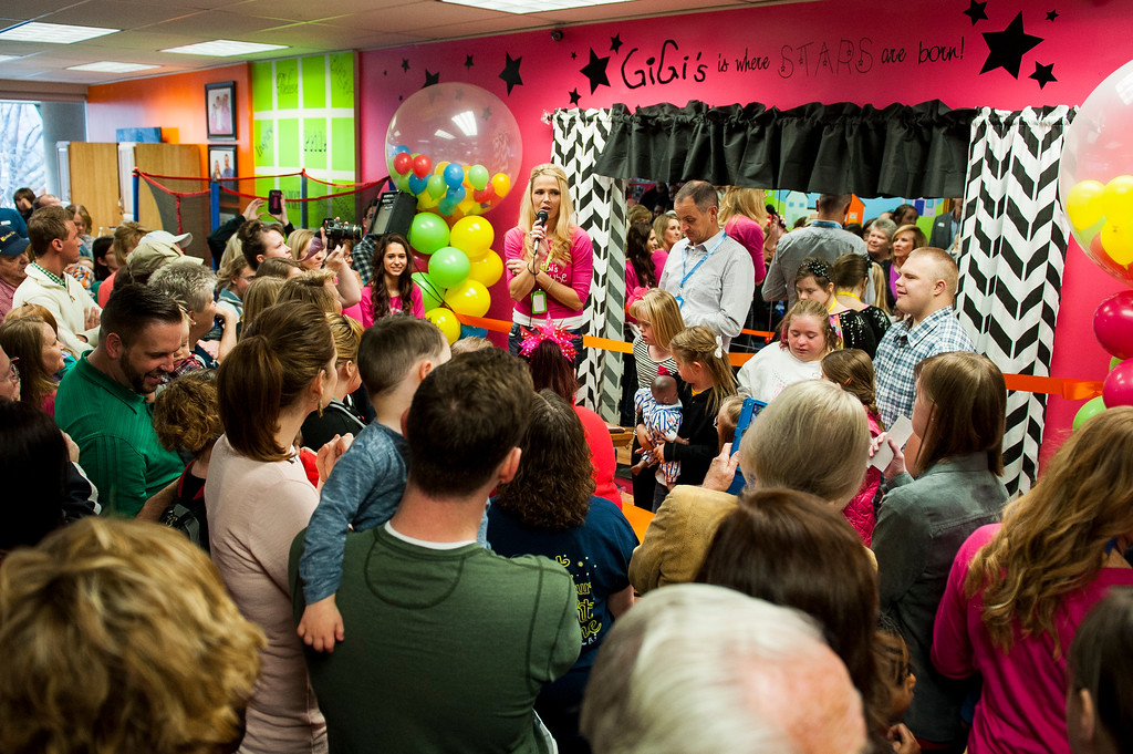 "Brittany Flint (center), the founder and president of Gigi's Playhouse, addresses a packed crowd of volunteers, board members, parents and children at the center's grand opening in Layton on February 7, 2015. Flint wants to express to the community that ""the purpose of the playhouse is to help our children be the best that they can be, dream to do whatever they want to do and also that we are raising expectations that children and adults with Down syndrome are just like a typical person it just might take a little bit longer."""