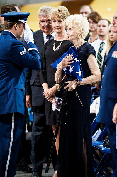 Airman Armstrong, of the United States Air Force Honor Guard, presents the US flag to Lt. Gen. (Ret) Marc C. Reynolds' wife, Ellie Reynolds at the funeral held on July 28, 2014 at the Hill Aerospace Museum. Reynolds was an integral part of expanding the museum to its current size and this was the first time that a funeral service has been held there. (ROBBY LLOYD/Standard-Examiner)