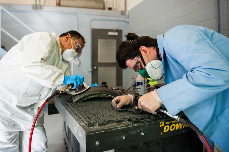 Hector Rivera (left) and Nate Caulford (right), students in the composites department at the Ogden Weber Applied Technology Center, work on their sanding techniques in Ogden on May 4, 2015.