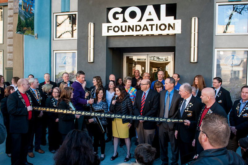 Mikelle Barberi Weil (center), GOAL Board President, speaks to the crowd who has gathered to watch the ribbon cutting and see the new GOAL Foundation offices located at 2440 Washington Boulevard in Ogden on March 26, 2015.