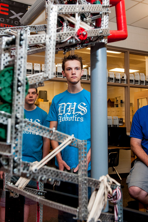 Isaac Froisland, a senior at Davis High School, maneuvers a robot to drop plastic cubes onto a PVC pipe in Kaysville, on May 4, 2015. Froisland along with team members Ryan Froisland and Quinn Evans (left) were recently crowned the world champions at the VEX Robotics Competition in Louisville, Kentucky.