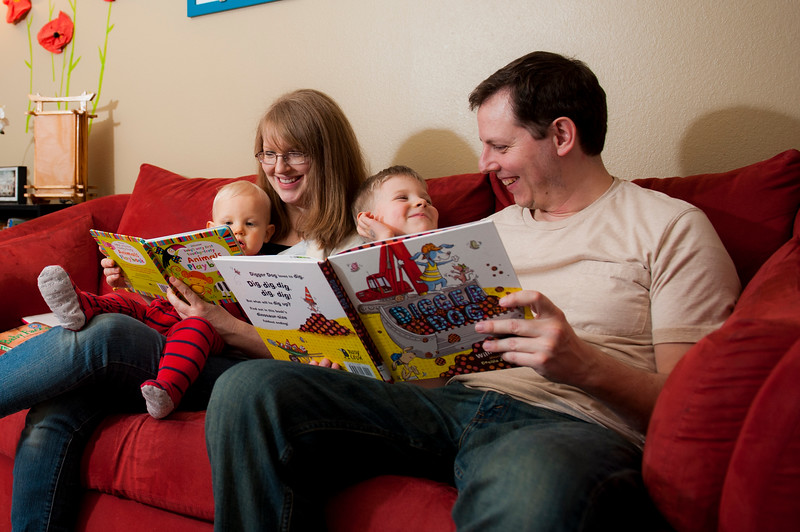 Deborah Smith and Russ Cullison read aloud to their children Sam, 1, and Rand, 4, before they put them down for bed in their home in Washington Terrace on February 27, 2015.