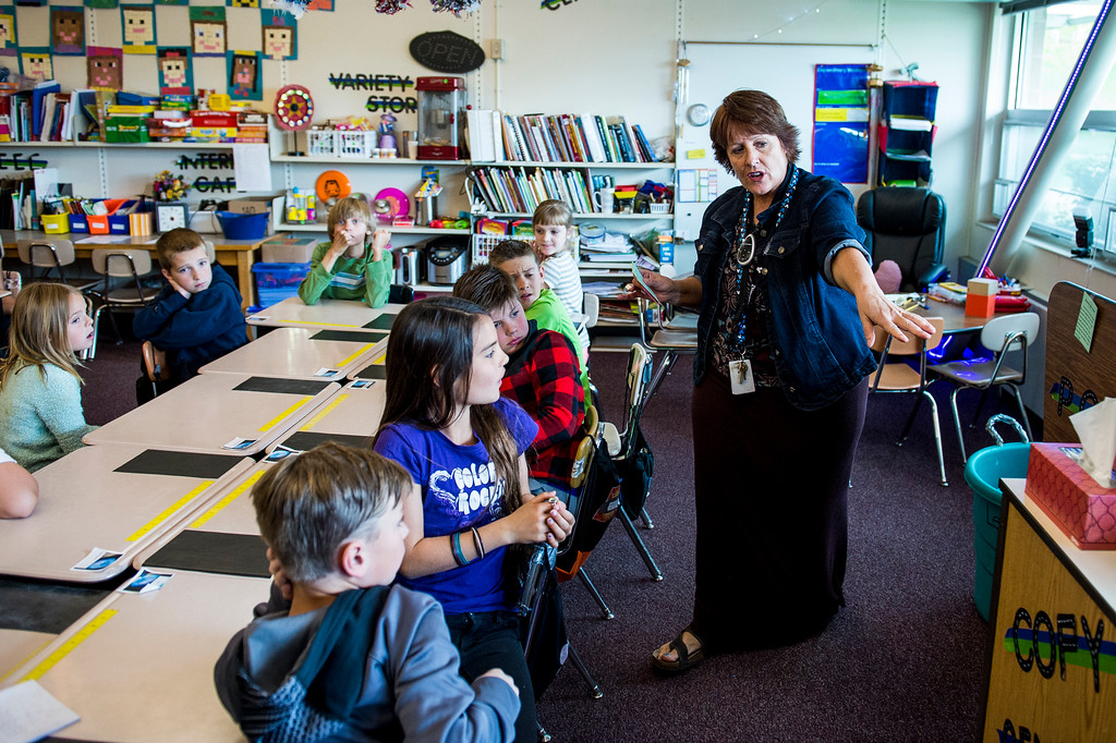 Dennise LeBaron gives instructions to her third grade class about a scavenger hunt activity they are to complete with a partner at Orchard Elementary School in North Salt Lake on April 25, 2016.