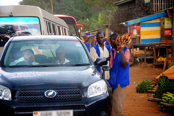 Selling Chicken On A Stick - A Roadside Market Near Kampala, Uganda