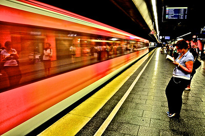 Passenger Reading As Fast Train Passes - Munich, Germany