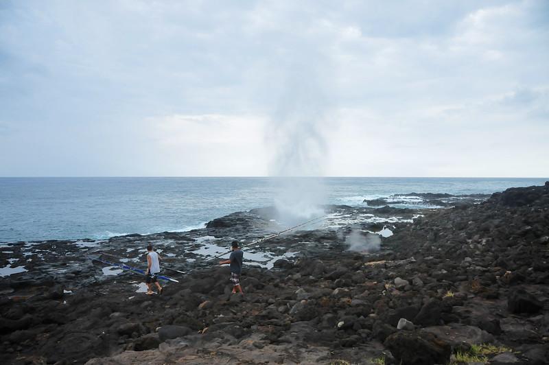 Two Fishermen Walk Past The Spouting Horn - Kauai