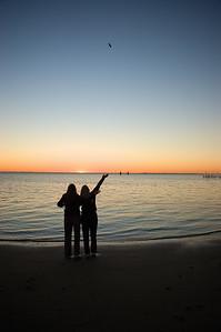 Mother and Daughter Enjoy A North Carolina Coastal Sunset from The Beach at Harker's Island, North Carolina