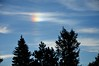 Sunlight Refracting Off Ice Crystals In Clouds