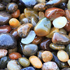 """Pebbles of Pebble Beach"" <br>Location: Pebble Beach, San Mateo, California.  <p></p><p>I think these pebbles are the highlight of this beach, which is also aptly named after them. The entire shore is covered by these incredibly beautiful bebbles. Since you are not allowed to take these home I took a picture of them instead.  </p><p>Tech Info: <br>Lens: Canon EF 100mm f/2.8L IS Macro <br>Camera: Canon EOS 5D Mk II <br>Exposure: 2sec at f/18 and ISO 200 <br>Filters: B+W Circular Polarizer  <br><br>The coastline of the Bean Hollow State Beach has one of the most unique rock formations. It is always a joy to visit this location and photograph it during sunset. There are no long sandy beaches to be found here but only the rugged stone formations eroded in strange and sometimes beautiful formations called ""tafoni"". I have been visiting here for many years and though I am somewhat satisfied with the images I have captured, I feel that the beauty of this place is best seen in person.  These are twin beaches, Bean Hollow State Beach and the Pebble Beach.  Both beaches are amazing with their rock formations, colorful pebbles, tide pools, tafoni and of course the open views of the pacific ocean.</p>"