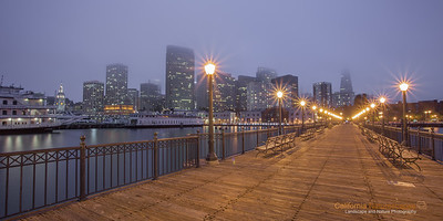"""Pier View"" Location: Pier 7 at Embarcadero, San Francisco, California.  Seafront area on Embarcadero has fine seafood restaurants, local bookshops, bakeries and coffee shops. Many of these places have fantastic ocean views and the ambiance is very lively. During summer months it is a perfect escape from the heat of the bay area since city is foggy and cool most of the days. A walk on pier 7 offers fantastic views of the ocean but what I like even more is the view looking towards the city.  Tech Info: Lens: Canon 17-40mm f/4L @31mm Camera: Canon 5D Mk II Exposure: 70sec at f/16 and ISO 50 Filters: No filters"
