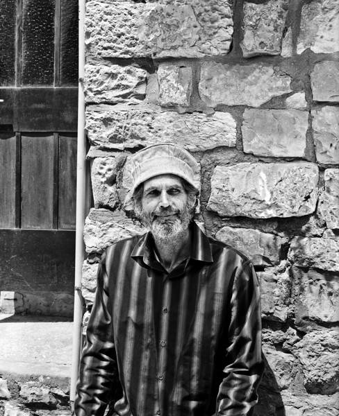 A man, resting in the shade in the city of Safed (aka Zefat or Tzfat) in the Northern Galilee section of Israel. (Scanned from black and white film.)