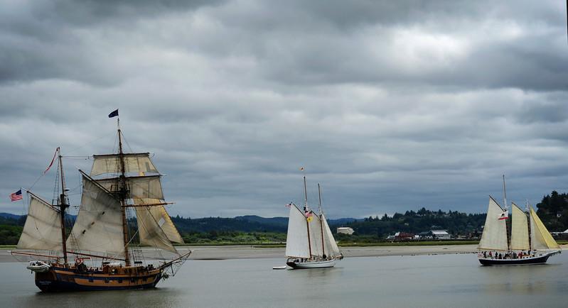Three replica ships sail through the bay in Coos Bay, Oregon during the Parade of Sail for the Festival of Sail kickoff and opening ceremonies at the Mill Casino in North Bend on June 1, 2017.