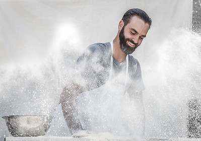 Artisan Pizza Chef slamming dough into flour. Photography from George Tenney's studio in Tempe, Arizona.