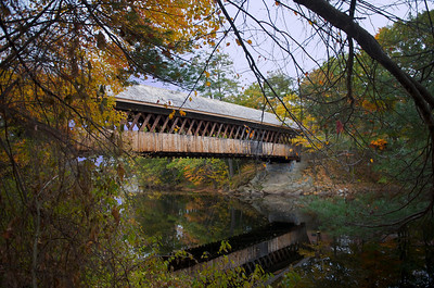 The Henniker bridge, built by Milton Graton and his son Arnold in 1972 using traditional methods. The bridge serves as a footbridge across the Contoocook River for New England College and the community of Henniker. The Henniker Bridge was constructed to replicate the traditional style of covered bridges, however, it has not yet reached the 50 year age criteria for listing on the National Register of Historic Places.