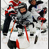 © Paul Conrad/ Pablo Conrad Photography<br /> <br /> Hockey players Steve Costales, Lochlan Lauer, 3; and Isabel Day at the Lewis Ice Arena in Aspen, Colo.
