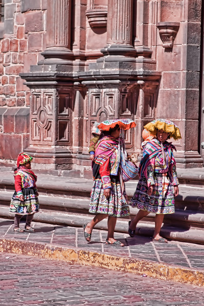 Two local ladies in Peru (Cusco) looking for tourist (like me) to take their photo.