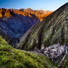 an Inca ruin along the Inca trail to Machu Picchu. It is built into a hillside overlooking the Urubamba River. The site consists of upper and lower house complexes connected by a staircase and fountain structures. Beside the houses lies an area of agricultural terraces.