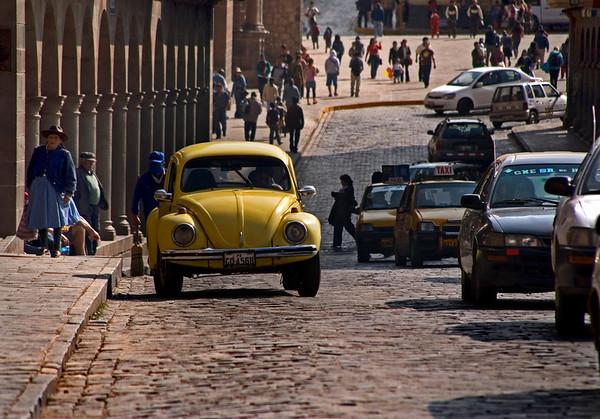 Volkswagen on cobblestone streets in Cuzco, Peru