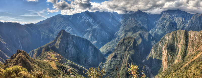 In this panorama I tried to show Machu Picchu and Aguas Calientes and the depth of the mountains as well as the sheer steepness. This Photo was taken at close to 13 thousand feet.