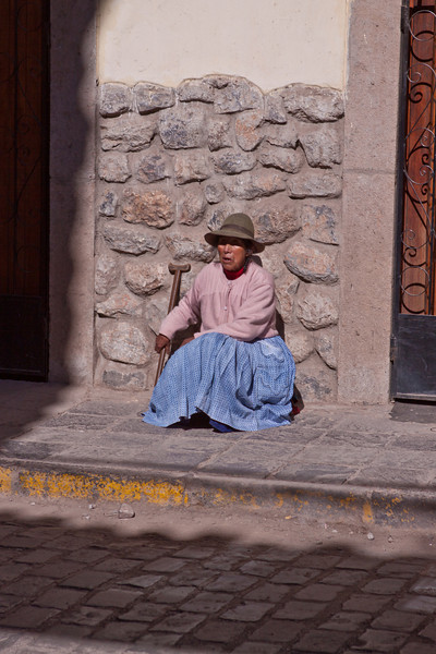 Local resting on the street in Cusco