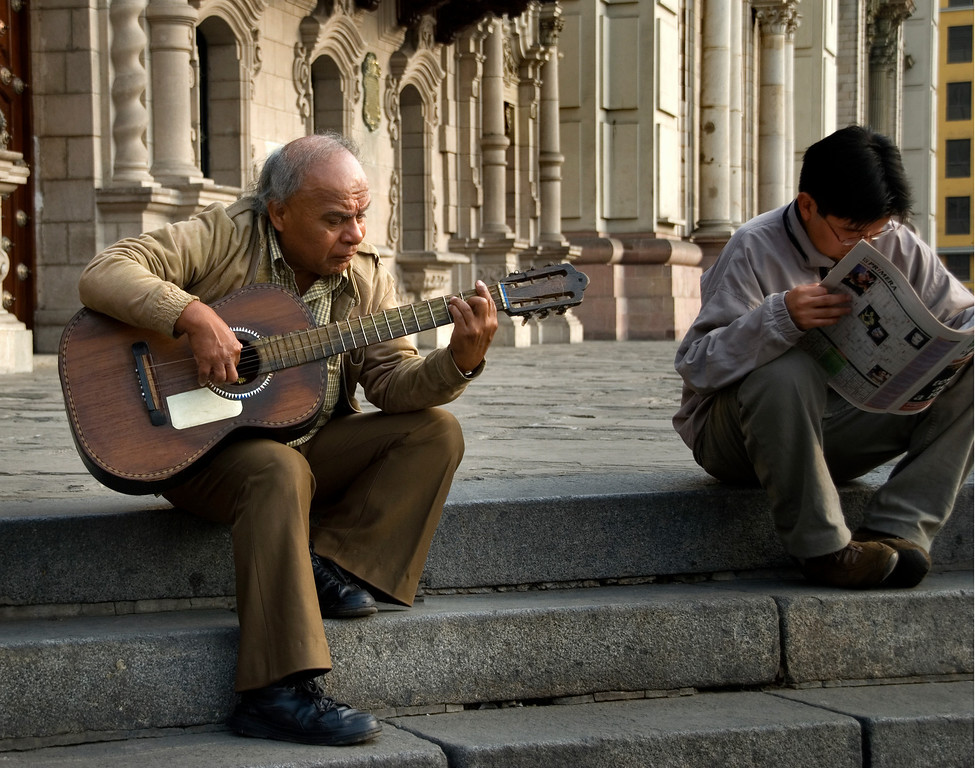 Guitar player on the steps of a church in Lima, Peru