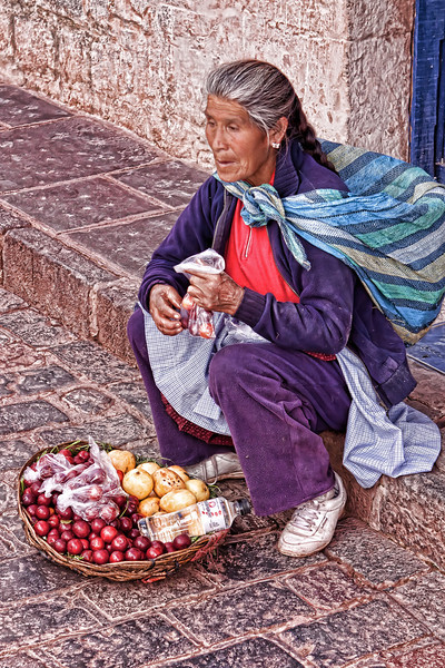 As many locals, this women sat quietly on the walk selling her goods, mainly to other locals.