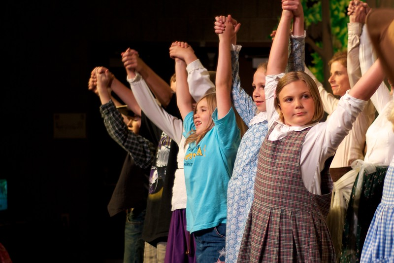 Day 306 -The cute little girl is Cecelia, who we've known since her birth and lived in a duplex with her and her parents.  She entered the world of community theatre this years.  Ok-la-HOMA!.  We got in the front row center.   There was an empty seat next to us, I believe it was for a Mr. Guffman.