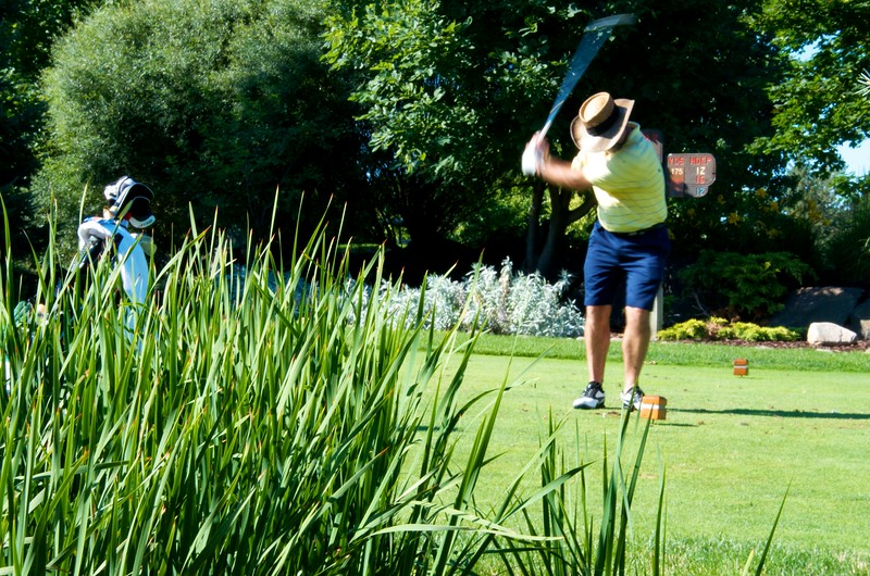 Day 322 -A beautiful day in MN and I was fortunate enough to play golf with my dear friend at his club.  Plus I'd be stupid not to put my boss in the photo a day project.  It's job security.  On that note.  Please call me for all your marketing and advertising needs.