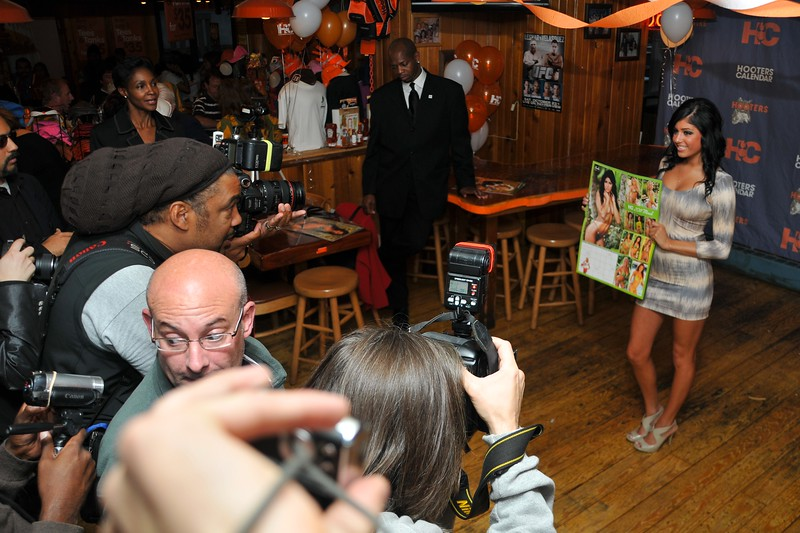 Day 031 -I recently signed up with an agency to do some papparozzo work.  Today was my second event at the Hooters calendar release party.  It's a little hard competing with all the photographers, but this was particularly bad due to all the dumb guys (exactly who you would imagine to be there) with cell phones taking photos.  I thought this kind of captured the moment a little.