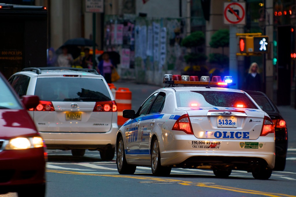 Day 022 -One of New York's finest starts up their lights on the way to catch some bad guys.  It appears to be a newer police car, so I'm glad my tax dollars are going toward something