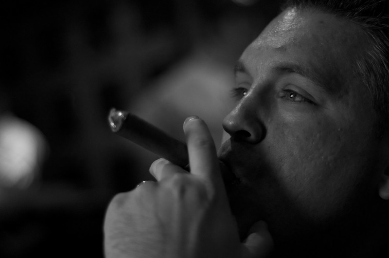 Day 207 -Dr. Anthony Klimek III enjoys a cigar while watching several fights during the Rangers Islanders game.  Truly a man's night.  Giving up color for Lent.