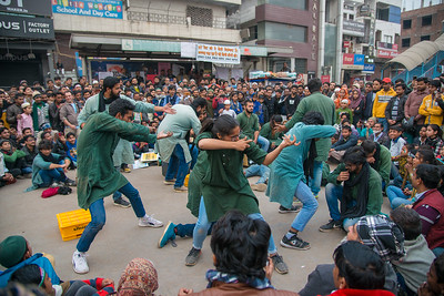 A group of students from universities in Delhi performing a road theatre against fascism targeting Indian government.