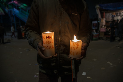 An anti-CAA protester with candles.