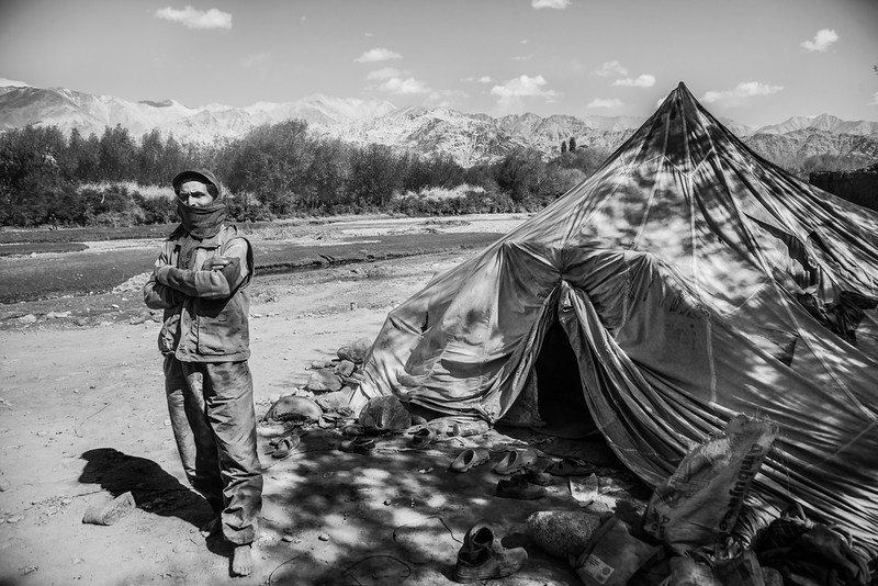 Bir Bahadur is from Nepal. Every summer, he comes to Ladakh for six months to build roads. This time, a contractor from Chandigarh gave him this job. He stays in a tent along with five other workers from Nepal.