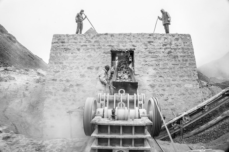 Workers building walls in an area which is prone to landslides.