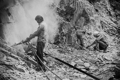 Using a drilling rig, a worker is widening the road in a mountain around 50 kilometres from  the famous Lamayuru monastery  – inhaling dust constantly in thin air where it can anyway get difficult to breathe.