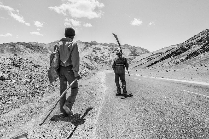 Two workers from Jharkhand walk towards their tent close to the Magnetic Hill as the day ends.