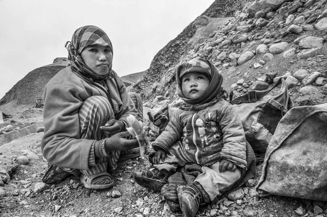 Pema brings her three-year-old son Ngodup to work. They live near Lukung village, close to Pangong Tso lake in eastern Ladakh. A few Ladakhi families also work along with the migrants to build the roads.