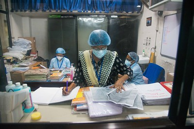 The heavily overworked hospital matron and sisters-in-charge have a crucial role in maintaining the whole system, supervising the well-being of the patients, and monitoring the duties of all the different health workers like nurses, ward assistants and sweepers. Here, matron Jharna Roy works on a job sheet inside her office.