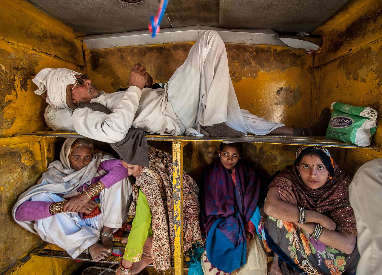 This gentleman was travelling with his entire family and insisted on occupying the top bunk all by himself.