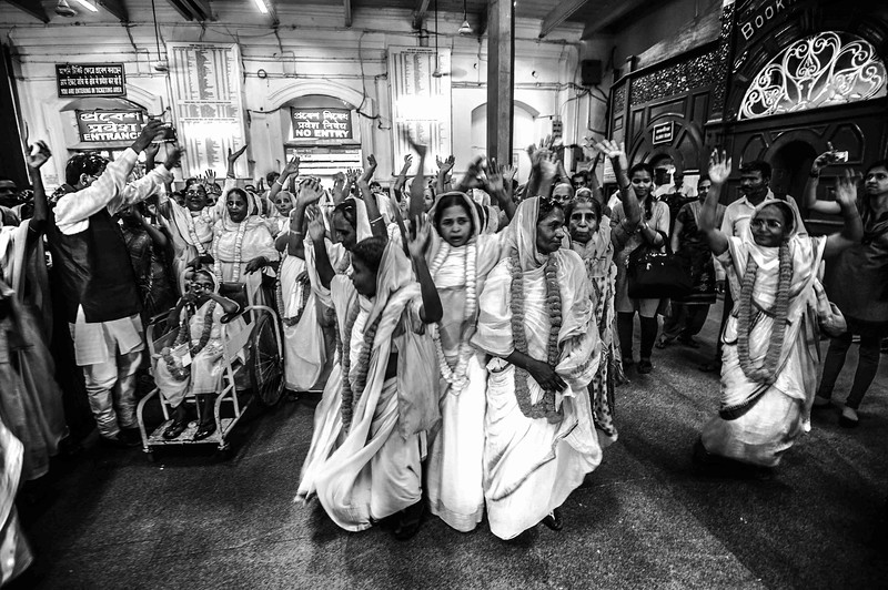 "They liven up the atmosphere within the premises of Howrah station with chants of ""Radhe Radhe"""