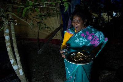 On the marriage evening, Pushpa Mondol carries food as an offering to his late husband Arjun Mondol's soul. It's a part of native practice practices.